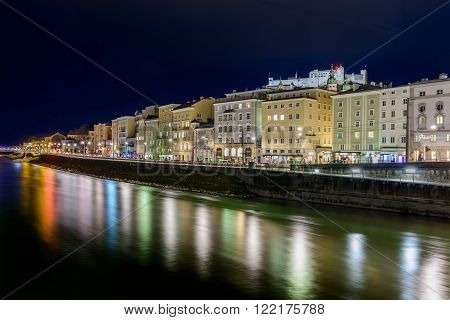 SALZBURG, AUSTRIA - FEBRUARY 09, 2016:  View of Salzburg at night with river salzach rudolfskai and Fortress Hohensalzburg