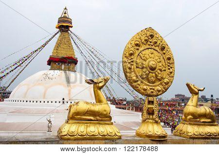 Golden statues in front of Bodhnath stupa in Kathmandu Nepal