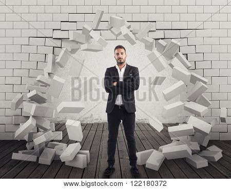 Man with a brick wall broken through