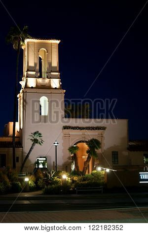 SAN DIEGO, UNITED STATES - DECEMBER 25: The entrance of the shopping center The Headquarters of Seaport with a illuminated tower in the early morning planted with palm trees on December 25 2015 in San Diego.