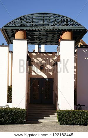 SAN JUAN CAPISTRANO, UNITED STATES - DECEMBER 25: The decorated lattice-like canopy entrance to the San Juan Capistrano Library in sunny weather on December 25, 2015 in San Juan Capistrano.