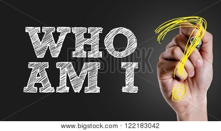 Hand writing the text: Who Am I?