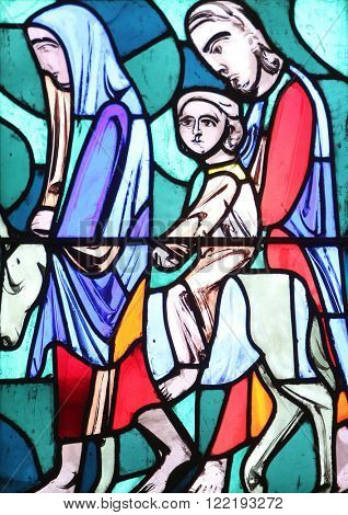 ELLWANGEN, GERMANY - MAY 07: The Flight into Egypt, stained glass window in Basilica of St. Vitus in Ellwangen, Germany on May 07, 2014.