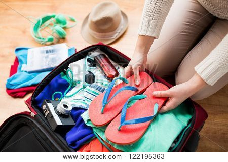 poster of summer vacation, travel, tourism and objects concept - close up of woman packing travel bag for vaca