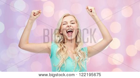 emotions, expressions, success and people concept - happy young woman or teenage girl celebrating victory over pink holidays lights background