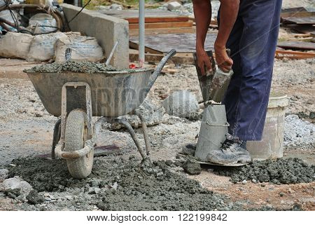 MALACCA, MALAYSIA -DECEMBER 23, 2015: Construction workers doing slump test using equipment at the construction site.