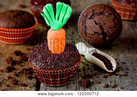 Happy Easter traditional food: chocolate cakes with carrots creative decor and original idea for Easter menu
