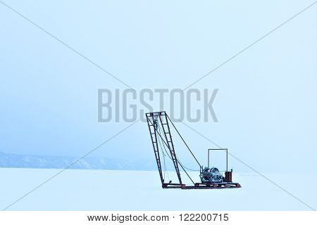 Winch for the study of ice outdoors during the winter. Russia Siberia. Science and research station on Lake Baikal. The study of the sun, the solar activity and earthquakes, seismic activity.