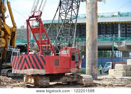 MALACCA, MALAYSIA - MARCH 12, 2015: Bore pile rig machine at the construction site in Malacca, Malaysia. The machine used to driven pile for building foundation work.