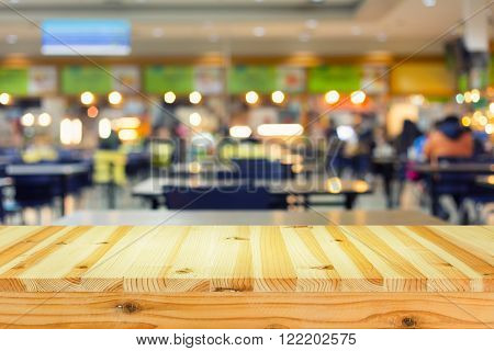 Defocused image of food court with table top.