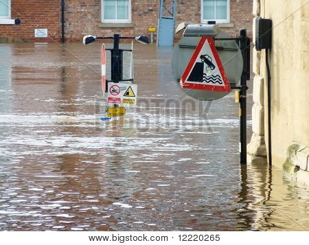 Telephoto view of submerged signs on flooded River Ouse
