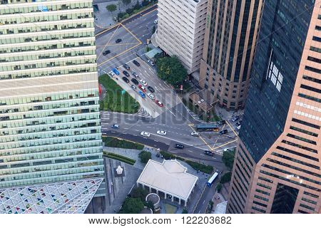 View downwards to the streets with cars between skyscrapers in Singapore ** Note: Visible grain at 100%, best at smaller sizes