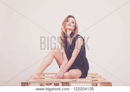 Model Posing To The Camera In Studio