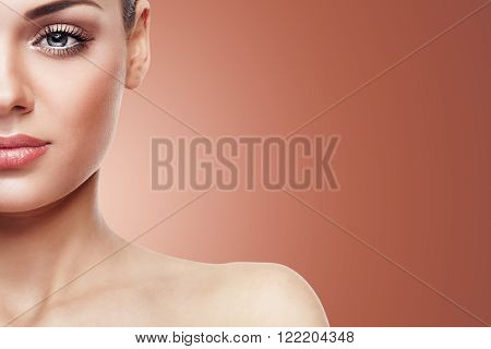Woman With Nude Make Up Isolated On Brown Background