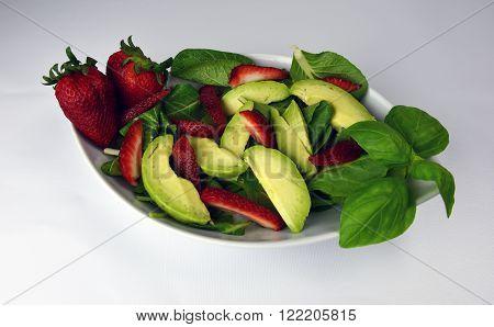 Fresh Avocado strawberry spinach kale bok choy basil salad isolated on white background