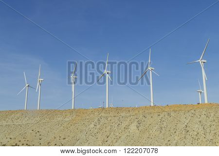 Windmill And The Desert