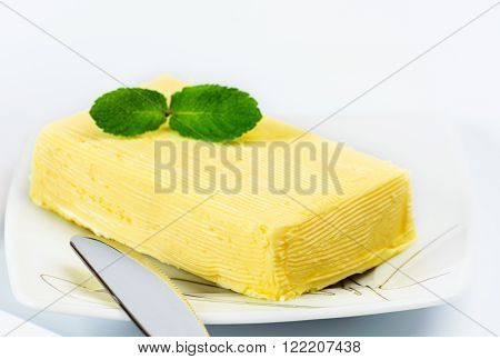 Briquette Butter And Sprig Of Mint.