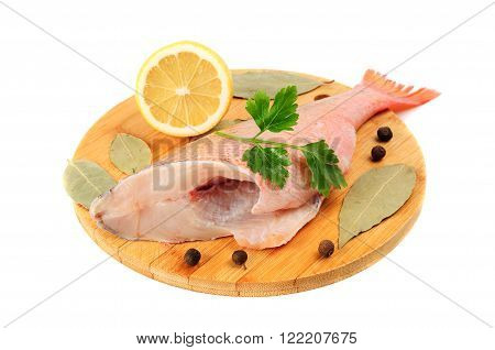 Gutted Sea Bass On The Cutting Board
