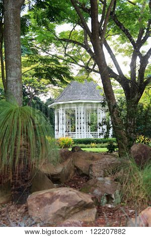 Singapore, Singapore - May 22, 2015: Bandstand in Singapore Botanic Gardens. The ocatgonal gazebo was erected in 1930 and staged early evening performances by military bands for many years.