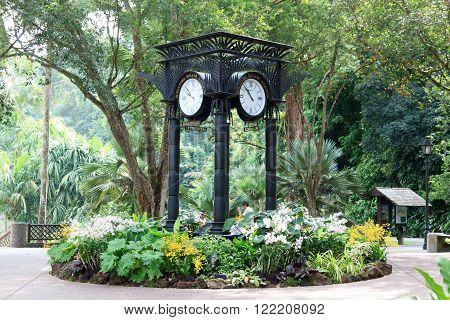 Singapore, Singapore - May 22, 2015: World clock near orchid garden in Singapore Botanic Gardens. The tropical garden is honored as a UNESCO World Heritage Site.