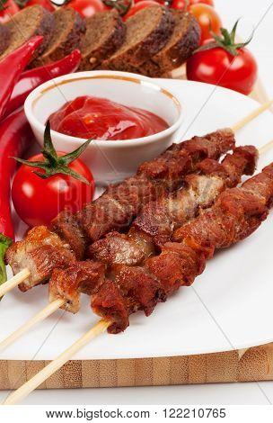Shish Kebab On Bamboo Sticks  White Plate