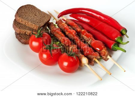Shashlik On A Plate With Cherry Tomatoes.
