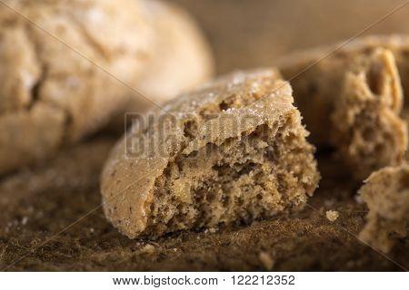 Detail of one broken Italian amaretti biscuit
