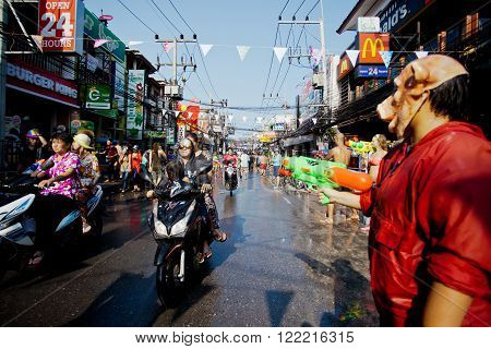 KO SAMUI THAILAND - APRIL 13: Chaweng Main Road at the celebration of the water fight festival or Songkran Festival (Thai New Year) on April 13 2014 in Ko Samui island Thailand