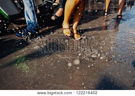 KO SAMUI, THAILAND - APRIL 13: Dance legs in a water fight festival or Songkran Festival (Thai New Year) on April 13, 2014 in Chaweng Main Road, Ko Samui island, Thailand.