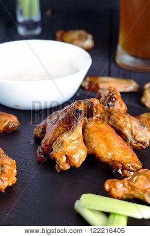 Plate of crispy delicious buffalo chicken wings