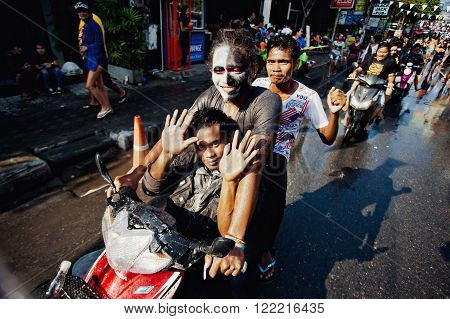 KO SAMUI, THAILAND - APRIL 13: Unidentified people on a bike in Songkran Festival (Thai New Year) on April 13, 2014 in Chaweng Main Road, Ko Samui island, Thailand.