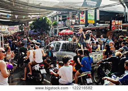KO SAMUI, THAILAND - APRIL 13: ?rowd of people at the celebration of the water fight festival or Songkran Festival (Thai New Year) on April 13, 2014 in Chaweng Main Road, Ko Samui island, Thailand.