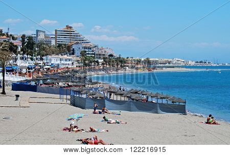 BENALMADENA, SPAIN - JUNE 2, 2008 - Tourists relaxing on the beach Benalmadena Costa del Sol Malaga Province Andalusia Spain Western Europe, June 2, 2008.