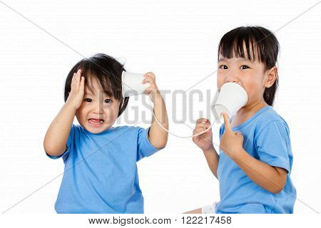 Asian Little Chinese Girls Playing with Paper Cups isolated on White Background