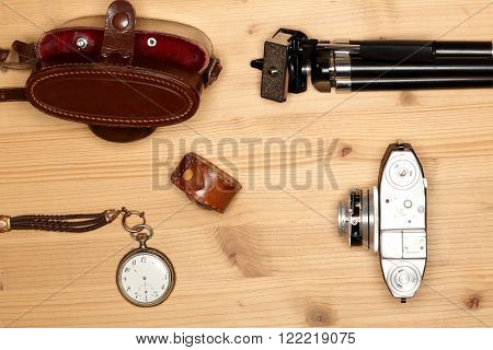 Photograph equipment on wooden table with camera and tools