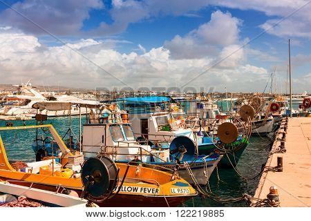 PAPHOS, CYPRUS - MARCH 14: Fishing boats in Paphos harbor on March 14, 2016.