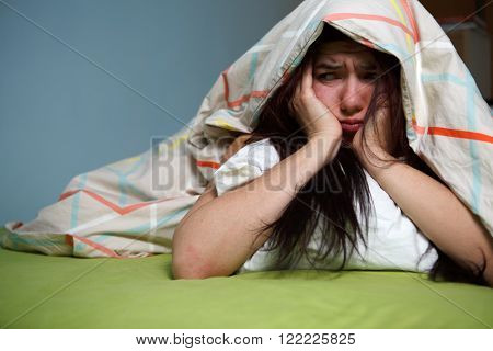 Woman with blanket under her head