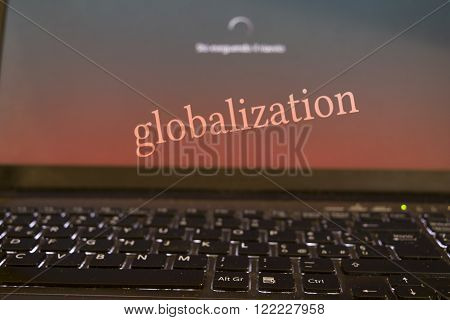 concept of globalizatione and modern technologies with a writen on the desktop of the a computer