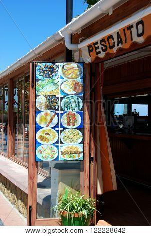 BENALMADENA, SPAIN - JUNE 2, 2008 - Beach bar entrance and menu board on the edge of the beach Benalmadena Costa del Sol Malaga Province Andalusia Spain Western Europe, June 2, 2008.