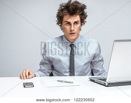 Businessman shocked what happened. Modern office man at working place, depression and crisis concept