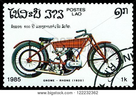 LAOS - CIRCA 1985: A stamp printed in Laos shows old motorcycle Gnome - Rhone. 1920 a series of motorcycles CIRCA 1985