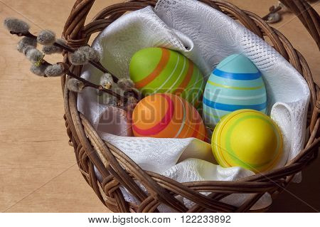 Easter eggs and catkins in a wicker basket