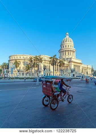 Havana, Cuba - April 2, 2012: Taxi Bicycle Near Capitolio