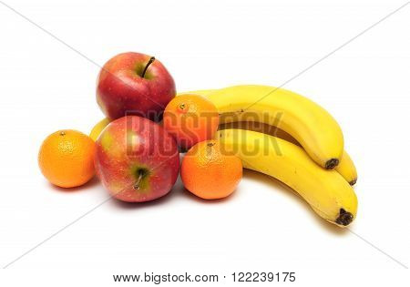 red apples tangerines and bananas close-up. white background - horizontal photo.