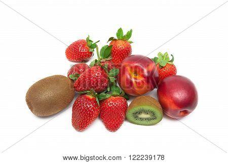 strawberries kiwi and nectarines on a white background. horizontal photo.