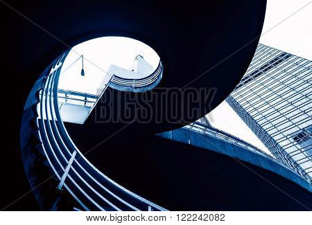 Outdoor spiral staircase under the viaduct, blue tone picture