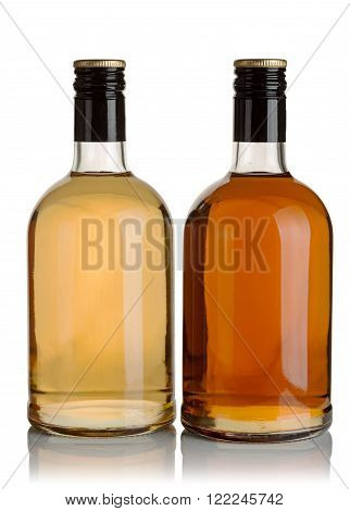 two bottles of liquor on a white background