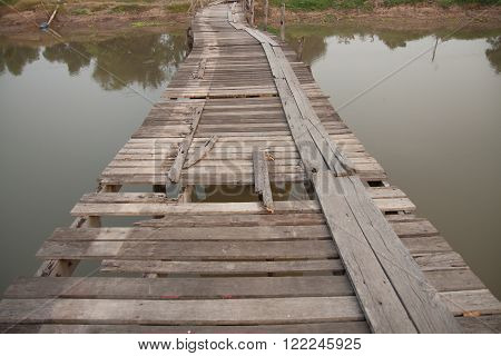 The old wooden bridge over the canal