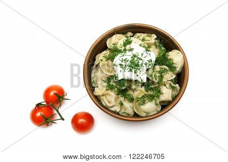 Russian dumplings with sour cream and cherry tomatoes. white background - horizontal photo.