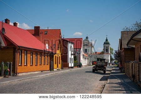 TYKOCIN, POLAND - MAY 10, 2010: View on the Church and traditional town buildings. Architecture of Tykocin